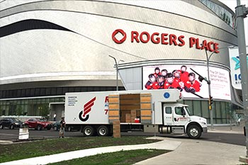 Moving truck in front of Rogers Place